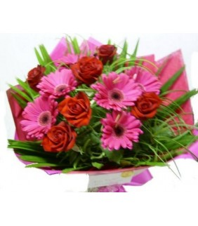 A vibrant mix of gerberas and roses presented in a bouquet
