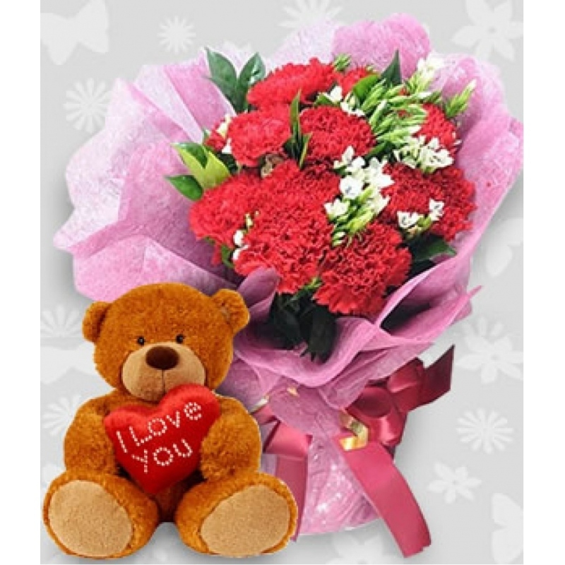 Huggable teddy bear with a bouquet of Flower mix